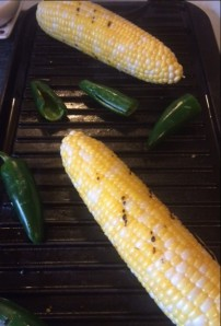 Grill roasting corn and jalapeno